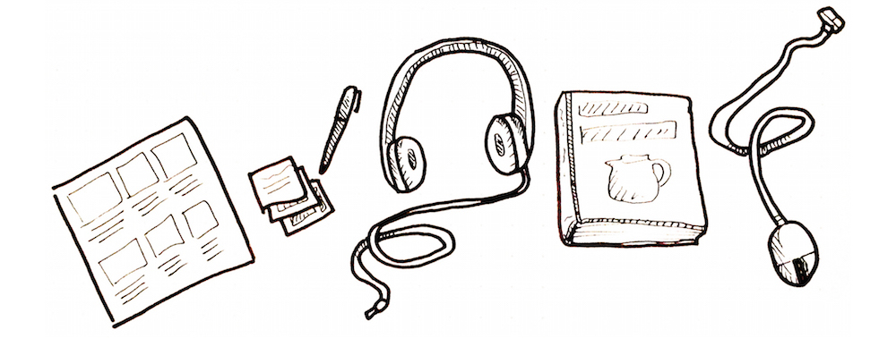 Image of a storyboard, sticky notes, a pen, a pair of headphones, a book, and a computer mouse